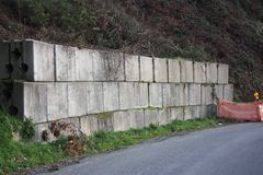 Road works. signs, containment boulders for landslides and mountain roads.  royalty free stock photo