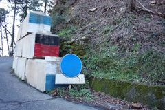 Road works. signs, containment boulders for landslides and mountain roads.  stock photography