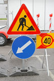 Road works. Traffic sign and direction arrow Stock Images
