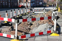 Road works UK. Road works in Liverpool, UK. Street repair sealed off with barriers royalty free stock image