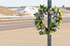 Road Wreath. Memorial Wreath of Flowers for Someone who Died in a Car Accident Stock Photo