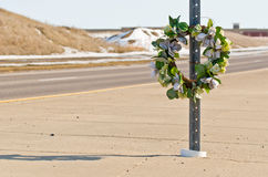Road Wreath. Memorial Wreath of Flowers for Someone who Died in a Car Accident stock images
