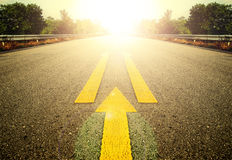 Road and Yellow arrow. Stock Images