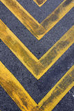 Road with yellow hazard stripes Royalty Free Stock Image