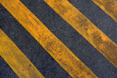 Road with yellow hazard stripes Stock Photos