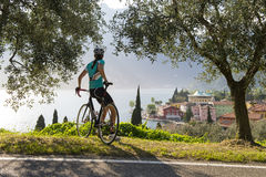 Roadbike girl take a break. Woman with bicycle enjoying the view Royalty Free Stock Photos