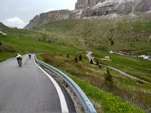 Roadbikers on dolomite mountain roadpass fast downhill Stock Photo