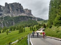 Roadbikers On Dolomite Mountain Roadpass Cycling Uphill Royalty Free Stock Photo