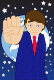 Roadblock To Globalization. An image of a businessman holding out his hand as if to say stop while the globe is suspended in the sky in the background Stock Photos