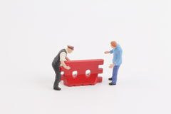 Roadblocks background with mini worker. Toys of mini people at the fun mini world Stock Images