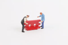 Roadblocks background with mini worker. Toys of mini people at the fun mini world Royalty Free Stock Image