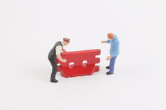 Roadblocks background with mini worker. Toys of mini people at the fun mini world Royalty Free Stock Photo