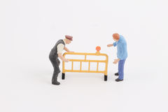 Roadblocks background with mini worker. Toys of mini people at the fun mini world Royalty Free Stock Photos