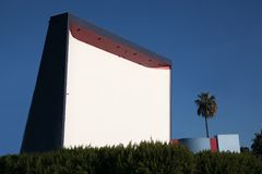 The Roadium in southern CA is a very popular drive in theater tu. Redondo Beach CA USA November 29th 2016  The Roadium drive in theatre screen entained familes Royalty Free Stock Image