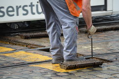 Roadman repairs streetcar rails Stock Photos