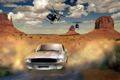 Roadmovie. White car in the desert of Monument Valley Royalty Free Stock Image