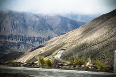 Roads. Mountainsides of Jujuy, Argentina lined with cacti and winding roads Stock Image