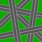 Roads. Network of crossing roads on a green background Stock Photo