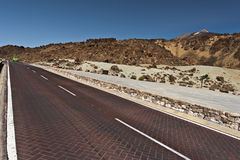 Roads across Tenerife national park. Road across Tenerife national park crossing the landscape of northern flank of Teide Volcano Royalty Free Stock Images