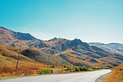 Roads in Azerbaijan. The road heads off to the old town of Altiagac in Azerbaijan in the foothills of the Caucasus Stock Image