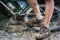 Roads of Eastern Crimea. Legs cyclist and the bike after the descent royalty free stock photos