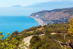 Roads of Eastern Crimea. The road and the bay on the background of mountains royalty free stock photos