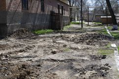 Roads in small town Russia. The roads in all the small towns of Russia look horrendous. The roads do not repair at all. Money for this government does not Royalty Free Stock Photos