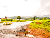 Roads in tropical Africa. Sodden after the rain the  road through the jungle in Liberia Royalty Free Stock Image