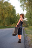 Roadside. Young woman waitin a car from the roadside Royalty Free Stock Image