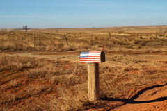 Roadside American mailbox. Rural mailbox painted with the American flag Stock Photos