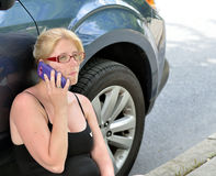 Roadside assistance - woman calling for help Stock Photography