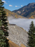 Roadside Attraction. Dense, pea soup fog fills a ravine during early Fall in the Rocky Mountains of Colorado royalty free stock images