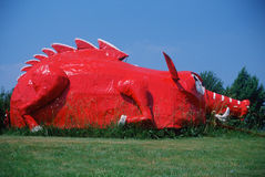 Roadside attraction of metal sculptured red dinosaur, Berryville AR royalty free stock image