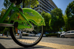 Roadside bicycles for rent in sunny summer Royalty Free Stock Images