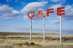 Roadside cafe sign. Worn down sign for a cafe on the side of a country highway Royalty Free Stock Images