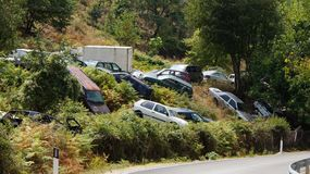 Roadside car cemetery in Albania. Left behind old junk cars next to road near Gjirokaster in Albania.n Royalty Free Stock Photo
