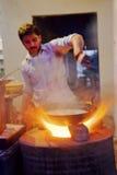 Roadside chef stirring pot curry stew. Kashmir Jammu, Northern India, Himalayas - December 18, 2011 Stock Photo