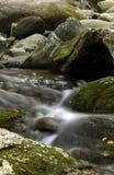 Roadside creek water flow Royalty Free Stock Images