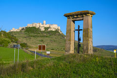 Roadside cross near ruin of Spis Castle, Slovakia. Roadside cross near ancient ruin of Spis Castle - Spissky hrad, National Cultural Monument UNESCO, Slovakia at royalty free stock photos