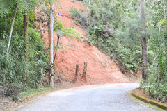 Roadside erosion. Erosion on the side of a paved road in Petropolis, Brazil, as the result of deforestation stock photo