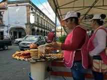 Roadside food stall. Sidewalk street food vendor cooking a meal in Patzcuaro, Mexico. Taken 4 November 2016 stock photos