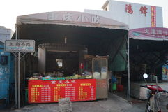 Roadside food stalls, the workers are eating snacks Stock Images