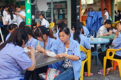 Roadside food stalls, the workers are eating snacks Stock Photos