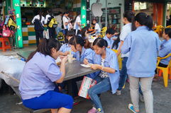 Roadside food stalls, the workers are eating snacks Royalty Free Stock Photo