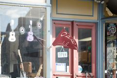 Roadside gift shop with some guitars hanging on the windows. Lancaster, Pennsylvania, United States, March 3 2018: Roadside gift shop with some guitars hanging Stock Images