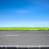 Roadside grass and blue sky royalty free stock photography