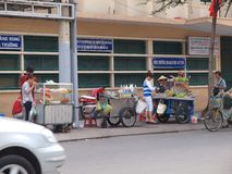 Roadside Hawkers in Vietnam. Hawkers selling food on the roadside Stock Image