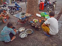 Roadside Hawkers in Vietnam. Hawkers selling shell food on the roadside Royalty Free Stock Photos