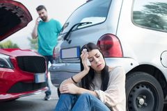 Roadside insurance emergency call after on the road car crash royalty free stock photos
