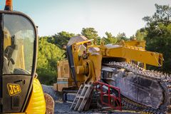 Roadside Machinery JCB and a tarmac grinder/remover royalty free stock photography